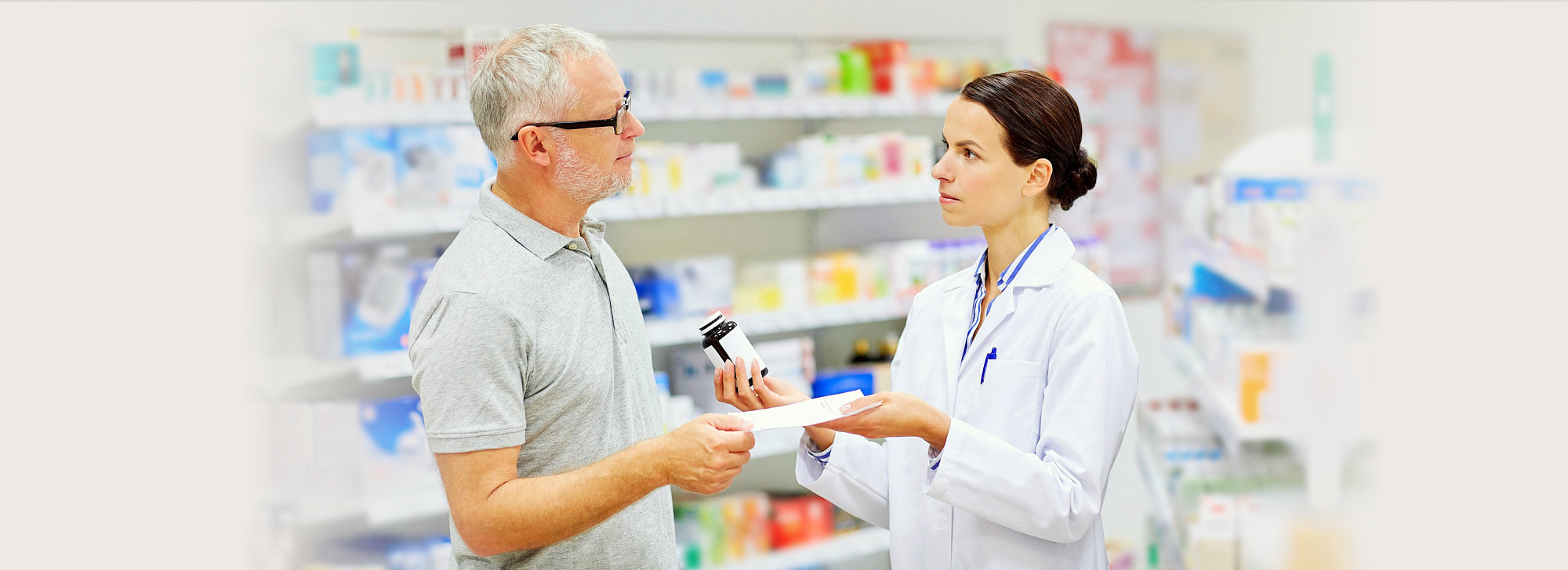 pharmacist and customer looking each other