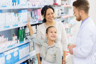 pharmacist and family in the pharmacy